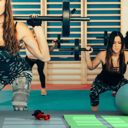 Fotomural Gimnasio Chicas Body Pump Sentadillas